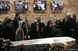 Mourners, including Dina Eidman (front row, third from left), mother of Russian leading opposition figure Boris Nemtsov, and Mikhail Kasyanov (center, rear), an opposition leader and former Russian prime minister, attend a memorial service before the