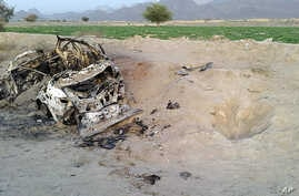 Photo taken on cellphone purports to show the destroyed vehicle in which Mullah Mohammad Akhtar Mansour was traveling in the Ahmad Wal area in Baluchistan province of Pakistan, near Afghanistan's border, May 22, 2016.