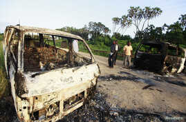 Wreckages of burnt cars are seen along the main road to Lamu from Mpeketoni after unidentified gunmen attacked the coastal Kenyan town of Mpeketoni, June 16, 2014.