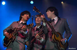 A Beatles tribute band plays at the dilapidated Washington Coliseum on the 50th anniversary of The Beatles' first North American performance at the venue in Washington, Feb. 11, 2014.