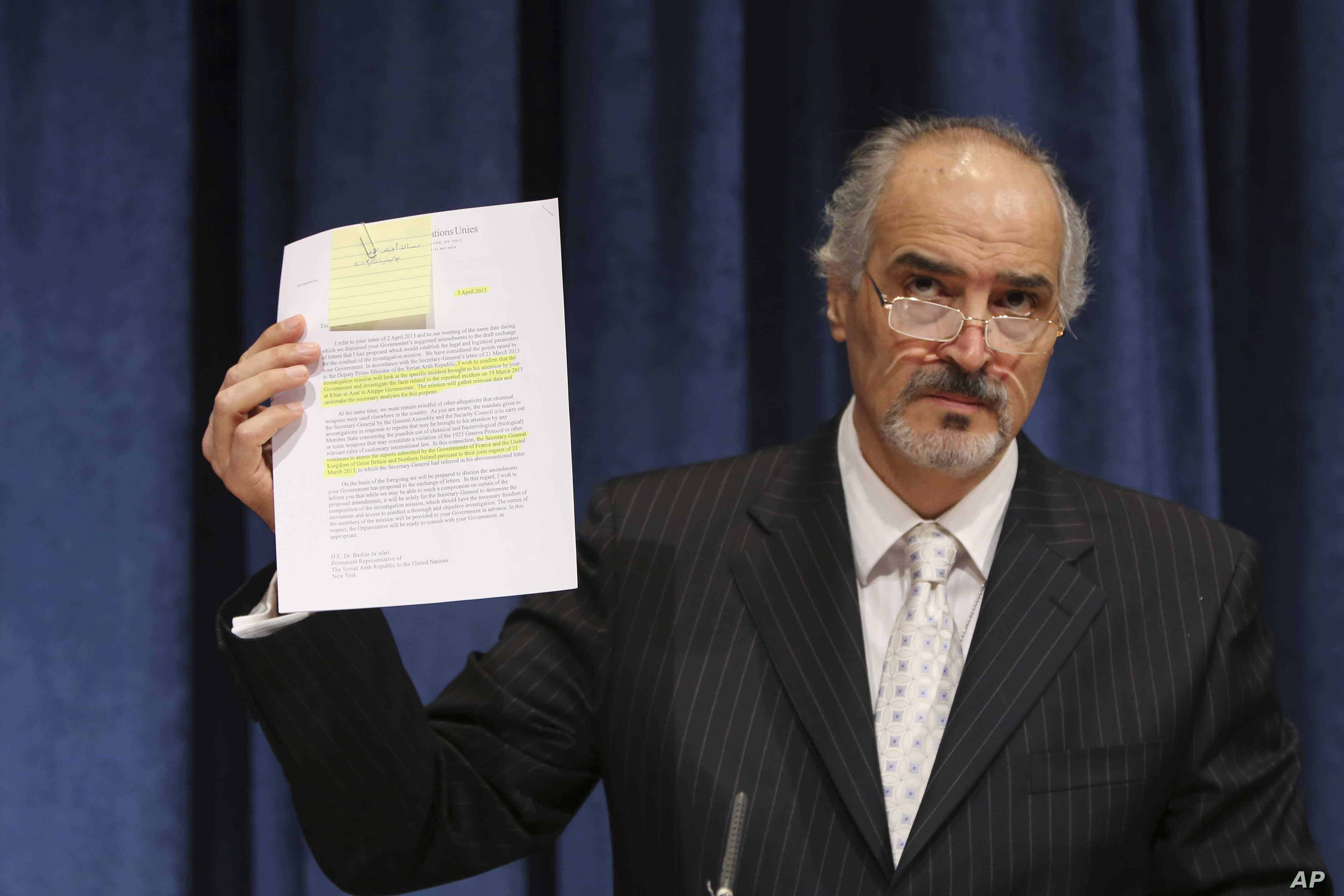 Bashar Ja'afari, Permanent Representative of the Syrian Arab Republic to the United Nations, gestures as he speaks during a news conference, Apr. 30, 2013 at U.N. headquarters.