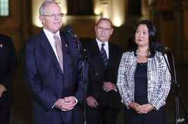 Peru's President Pedro Pablo Kuczynski, left,speaks as opposition leader and daughter of Peru's jailed former President Alberto Fujimori, Keiko Fujimori, right, looks on after their meeting at government palace in Lima, Peru, July, 11, 2017.