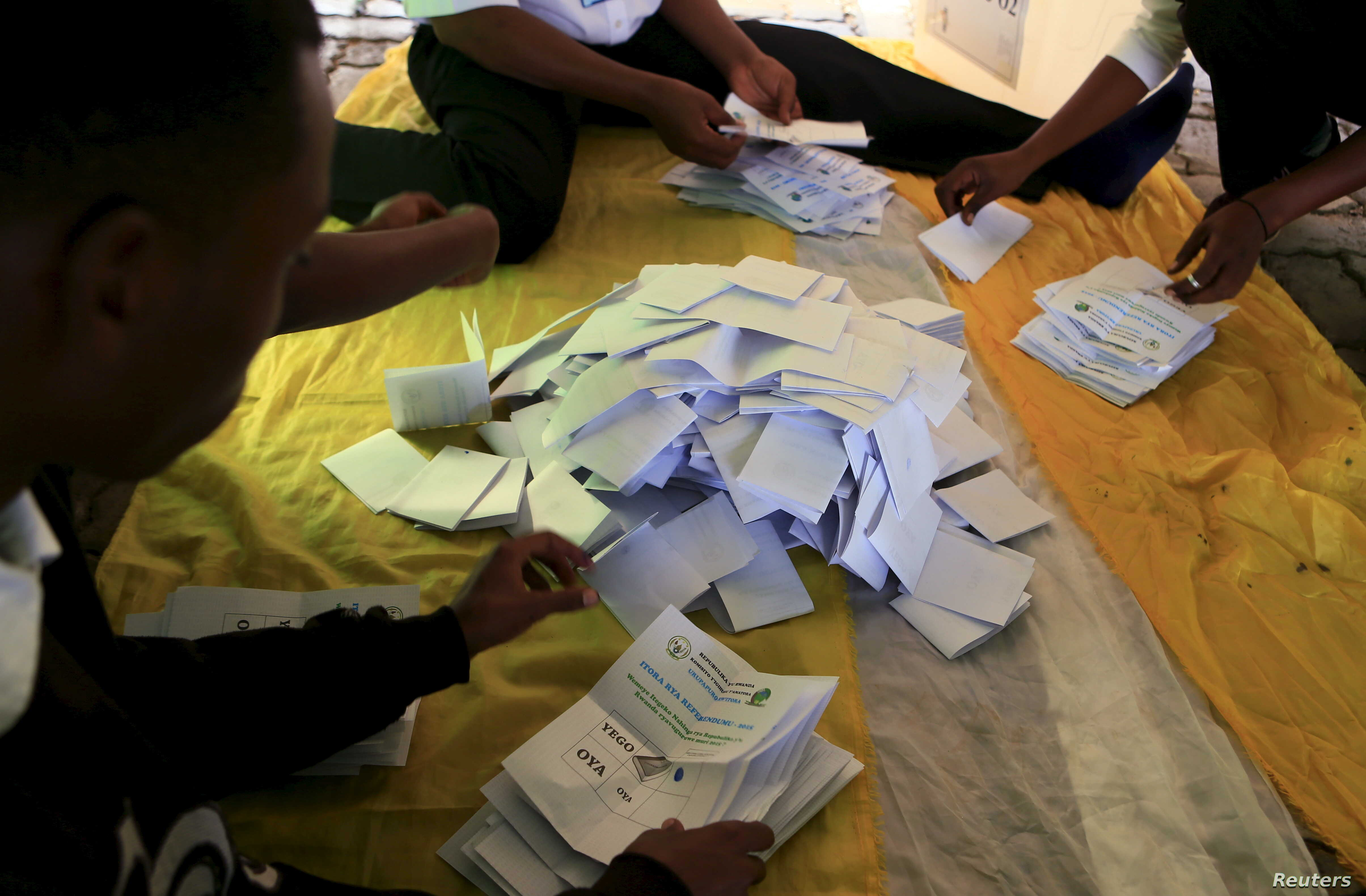 Rwanda election officials in Kigali count votes cast in a referendum on amending the nation's constitution to allow President Paul Kagame to seek a third term during next year's election, Dec. 18, 2015.
