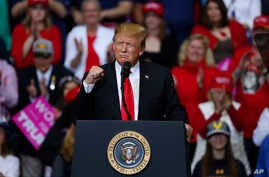 President Donald Trump speaks during a rally in Grand Rapids, Mich., March 28, 2019.