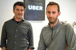 FILE - Then-Uber CEO Travis Kalanick, left, and Anthony Levandowski, co-founder of Otto, pose in the lobby of Uber headquarters, in San Francisco, Aug. 18, 2016. Uber said, in a June 22, 2017, court filing, that it hired Levandowski, a former Google ...