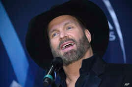 Musician Garth Brooks speaks in the press room after winning the award for entertainer of the year at the 51st annual CMA Awards at the Bridgestone Arena, Nov. 8, 2017, in Nashville, Tennessee.