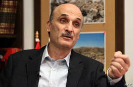 FILE - Lebanese Forces party leader Samir Geagea speaks during an interview with AFP in Maarab, northeast of Beirut, April 26, 2012.