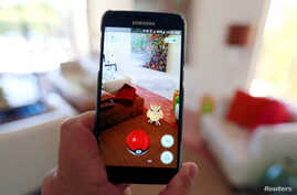 Nintendo's augmented reality mobile game 'Pokemon Go,' banned in many countries, is shown on a smartphone screen in this photo illustration taken in Palm Springs, California, July 11, 2016. (Reuters)