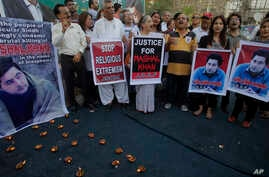 FILE - Members of a Pakistani civil society take part a demonstration against the killing of Mohammad Mashal Khan, a student at the Abdul Wali Khan University in the northwestern city of Mardan, in Karachi, Pakistan, April 22, 2017. A mob in the nort