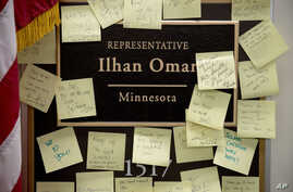 People leave post-it notes outside the office of Rep. Ilhan Omar, D-Minn., on Capitol Hill, Feb. 11, 2019, in Washington.
