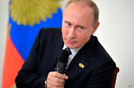 Russian President Vladimir Putin speaks to Russian journalists during a news conference following the BRICS summit in Goa, India, Oct. 16, 2016. Putin is denying allegations of Russian government interference with the U.S. election process.