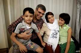 FILE - Iranian lawyer Nasrin Sotoudeh poses with her husband, Reza Khandan, her son Nima (L) and her Daughter Mehraveh (R ) at her house in Tehran on September 18, 2013, after being freed after three years in prison.