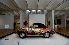 FILE - 1965 Porsche Type 356 C Cabriolet that once belonged to Janis Joplin on display in the Porsche By Design Seducing Speed exhibit at the North Carolina Museum of Art in Raleigh, N.C.