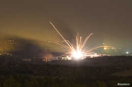 An Israeli rocket is fired into the northern Gaza Strip, July 17, 2014.
