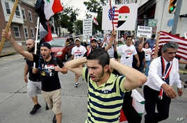 Members of the local Syrian community march in protest against the United States' involvement in Syria, Aug. 30, 2013, in Allentown, Pennsylvania.