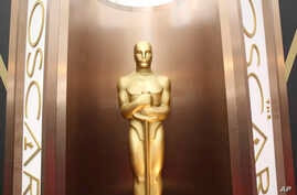 FILE - An Oscar statue is displayed at the Oscars at the Dolby Theatre in Los Angeles.
