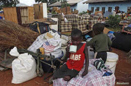 Zimbabwean children sit among salvaged possessions at a transit camp for over 100 families displaced by floods near the Tokwe-Mukorsi dam about 430km (267 miles) south of Harare, Feb. 13, 2014.