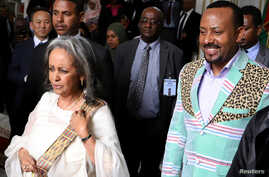 Ethiopia's Prime Minister Abiy Ahmed walks with newly-elected President Sahle-Work Zewde, as they leave the parliament building in Addis Ababa, Ethiopia, Oct. 25, 2018.