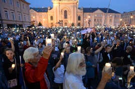 Opposition supporters shout slogans and raise candles as they protest in front of the Supreme Court against a law on court control in Warsaw, Poland, July 21, 2017. The bill on the Supreme Court has drawn condemnation from the European Union and has