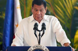 Philippine President Rodrigo Duterte addresses the crowd during a news conference prior to boarding his flight for a three-day official visit to Japan at the Ninoy Aquino International Airport in suburban Pasay City, south of Manila, Philippines, Oct