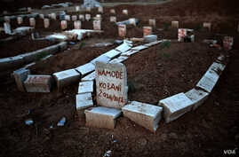 Graves of Kurdish people killed fighting alongside People's Protection Units (YPG) against Islamic State (IS) jihadists for the control of the mainly-Kurdish Syrian town of Kobani, also known as Ain al-Arab, in the cemetery of the Turkish town of Sur