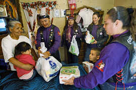 A group of Mexican women hand out aid in a low-income Ciudad Juarez neighborhood on Jan 23 201