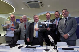 From left to right, Barry Biffle, chief executive officer of Frontier Airlines, Barry Eccleston, president of Airbus Americas, Bill Franke, managing partner of Indigo Partners, John Leahy, chief operating officer – Customers of Airbus, Jozsef Varadi,