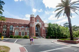 FILE - Students are seen walking on the campus of Florida State University in Tallahassee, Florida, April 30, 2015.