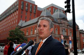 FILE - Colombia's President-elect Ivan Duque speaks with reporters after a meeting with Vice President Mike Pence in Washington, July 5, 2018.