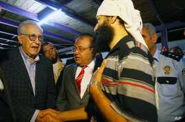 U.N. Syria envoy Lakhdar Brahimi, tasked with ending the 18-month conflict, left, speaks with refugees in Altinozu, Hatay, southern Turkey, Sept. 18, 2012.
