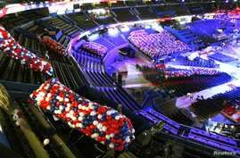 Workers carry balloons to be dropped from the ceiling at the Republican National Convention in Tampa, Florida, August 24, 2012.