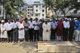 Bangladeshi Muslims attend the funeral of Xulhaz Mannan, who was stabbed to death by unidentified assailants, in Dhaka, Bangladesh, April 26, 2016.