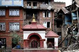 A small temple structure is seen undamaged amidst rubble of damaged buildings at the heritage town of Bhaktapur on April 29, 2015, following a 7.8 magnitude earthquake which struck the Himalayan nation on April 25.
