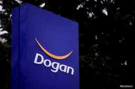 FILE - The logo of Dogan Holding is pictured at its headquarters in Istanbul, Turkey, January 5, 2017.