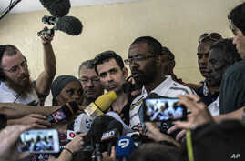 Relatives of Ethiopian-Israeli Avraham Mengisto, 28, hold a press conference in the costal city of Ashkelon, Israel, July 9, 2015.