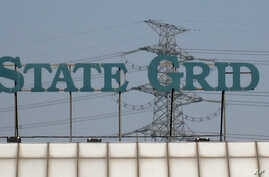 FILE - A State Grid sign is seen above a State Grid training center in Beijing.