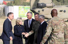 U.S. Defense Secretary James Mattis and NATO Secretary General Jens Stoltenberg, center, are welcomed by U.S. General John Nicholson after arriving at Resolute Support Mission headquarters in Kabul, Afghanistan, Sept. 27, 2017.