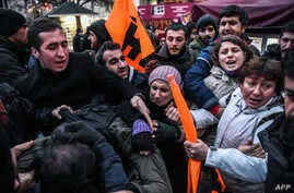 FILE - People scuffle as Turkish police detain protesters on December 23, 2016, on Istiklal avenue in Istanbul, during a protest in reaction to a video released the previous day by the Islamic State group purportedly showing two captured Turkish sold