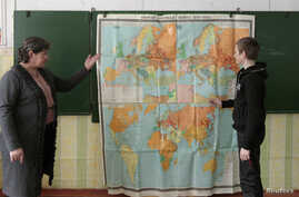 FILE - A teacher leads a history lesson for seventh graders in the Russian village of Bolshie Khutora, about 440 km west of Moscow.