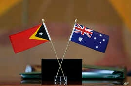 The flags of East Timor, left, and Australia are displayed during a ceremony at United Nations headquarters, March 6, 2018.