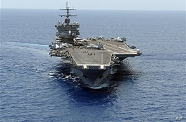 In this photo provided by the US Navy, an aerial bow view of the aircraft carrier USS Enterprise is shown as it transits the Atlantic Ocean (File Photo)