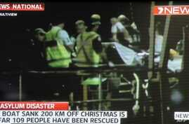 Screen grab shows asylum-seeker survivors arriving at Christmas Island after their boat capsized 120 nautical miles north of Christmas Island, 2,600 kilometres (1,600 miles) from the Australian mainland, June 22, 2012