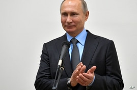 FILE - Russian President Vladimir Putin applauds while speaking to workers of the Rostselmash, a Russian agricultural equipment company in Rostov-on-Don, Russi.