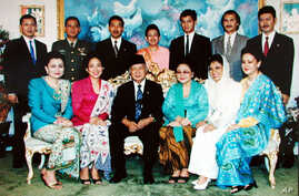 "FILE - Hutomo Mandala Putra, popularly known as ""Tommy"", top row third from left, youngest son of former Indonesian President Suharto, bottom row third left, is pictured in this undated family photo in Jakarta, Indonesia."