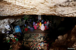 Internally displaced children attend a class inside a cave in the rebel-controlled village of Tramla, in Idlib province, Syria, March 27, 2016.