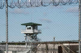 In this April 16, 2018, file photo, a guard tower stands above the Lee Correctional Institution, a maximum security prison in Bishopville, South Carolina.