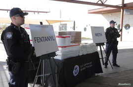 Packets of fentanyl mostly in powder form and methamphetamine, which U.S. Customs and Border Protection say they seized from a truck crossing into Arizona from Mexico, is on display during a news conference at the Port of Nogales, Arizona, Jan. 31, 2