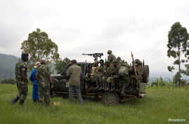 Congolese government soldiers prepare to drive from a military outpost between Kachiru village and Mbuzi hill, in eastern Democratic Republic of the Congo, May 25, 2012.