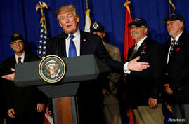 U.S. President Donald Trump delivers remarks before signing a proclamation commemorating the 50th anniversary of the Vietnam War during an event with U.S. military veterans in Danang, Vietnam, Nov. 10, 2017.