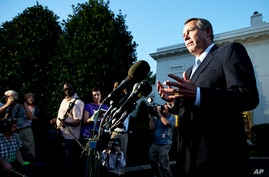 House Speaker John Boehner speaks to reporters following a meeting with President Barack Obama at the White House, Oct. 2, 2013.